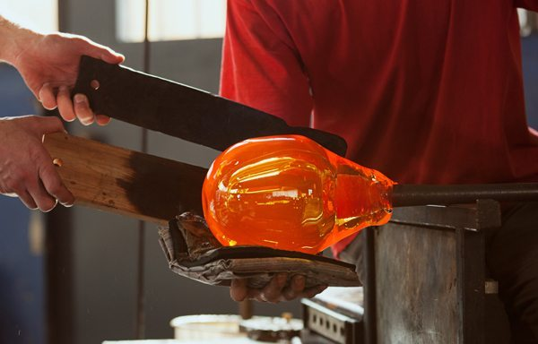 Glass: Artist Using a Pad to Shape Glass